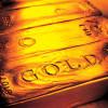 Aurul s-a scumpit pe fondul scăderii burselor